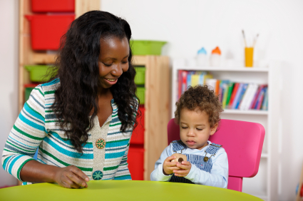 Child with Mom Practicing Speech Therapy
